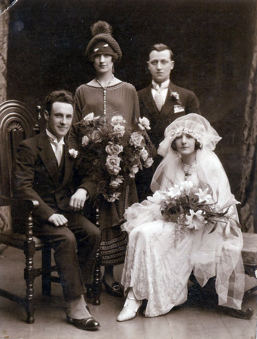 Elizabeth Fusco and Carmen Demarco standing at the rear of this photo.  Lucia Fusco is the bride. Edward Dunne Mayher is the groom. Date 1926