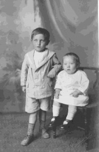 Siblings unknown dressed for the Camera